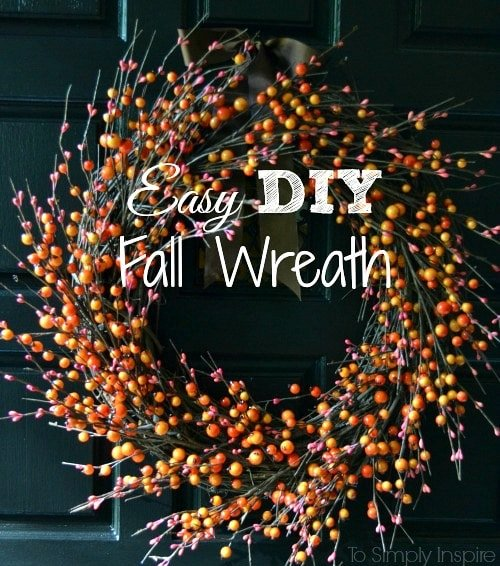 Orange and Red Berry DIY Fall Wreath on a black door