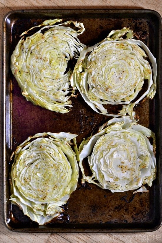 Baked cabbage slices on a baking sheet