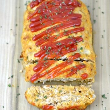 Turkey Meatloaf with tomato sauce on a wood cutting board