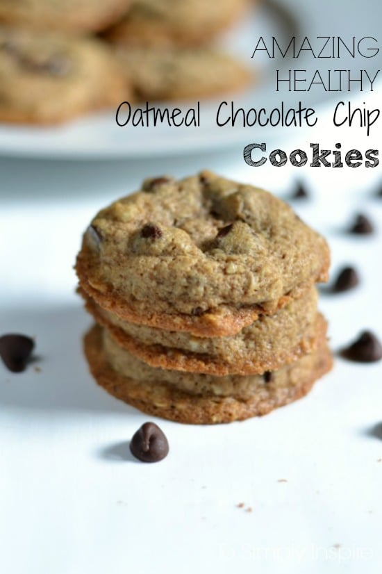 a stack of 3 chocolate chip cookes surrounded by chocolate chips