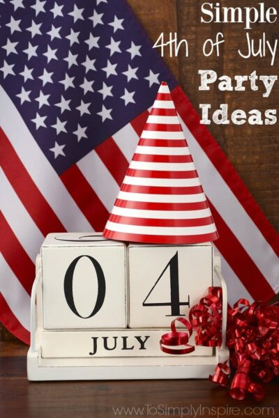 Fourth of July vintage wood calendar with flag and party hat and decorations on dark wood rustic background.