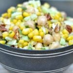A gray bowl of Chickpea salad and corn