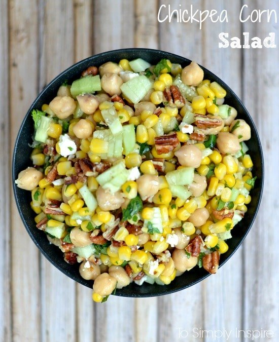 bowl full of chickpeas, corn, cucumber slices and pecans