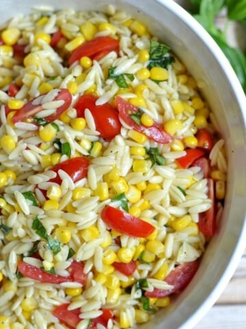 orzo pasta salad with sliced cherry tomatoes and corn