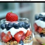 Yogurt Parfait with layers blueberries, strawberries and granola with text overlay