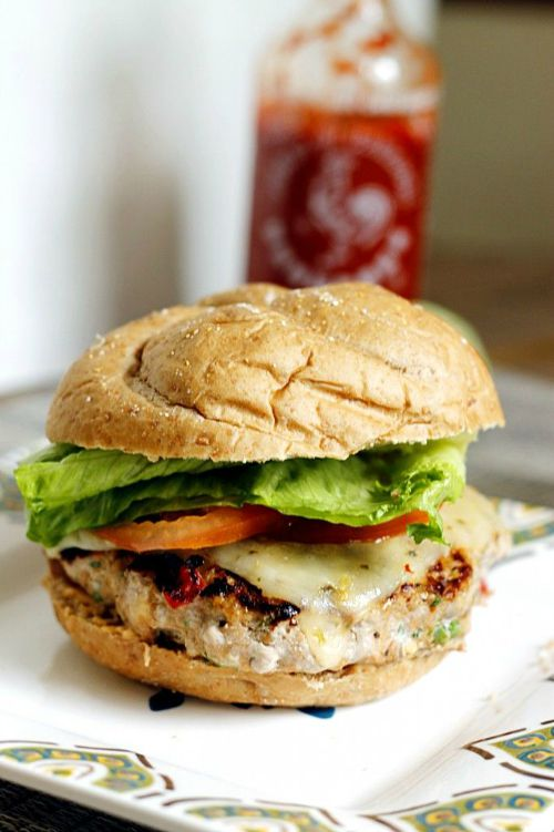 turkey burger topped with lettuce, tomato and cheese