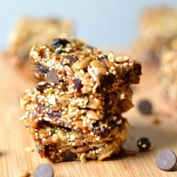 A stack of energy bars sitting on top of a wooden cutting board