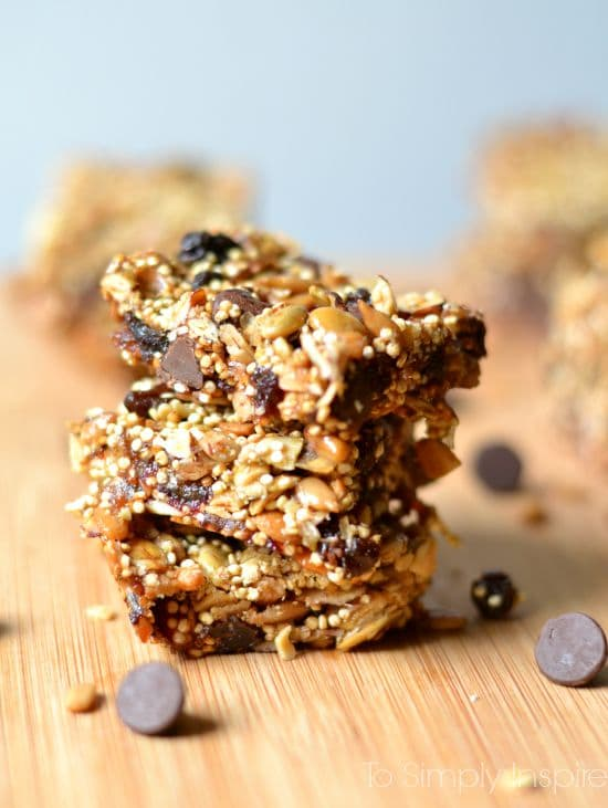 stack of 3 oat and quinoa energy bars with chocolate chips around