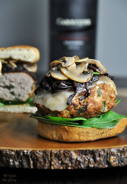 a turkey burger topped with sautéed onions and mushrooms