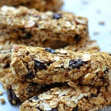 Granola bars with raisins stacked on a plate