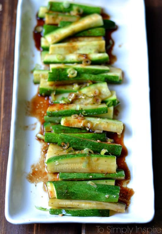 Spicy Asian Zucchini recipe on a white plate