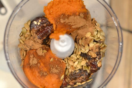 Ingredients for Pumpkin Pie Chocolate Chip Bites in a food processor