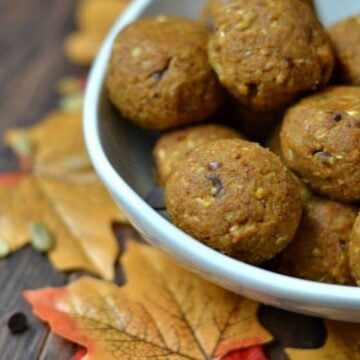 a white bowl with pumpkin chocolate chip energy balls