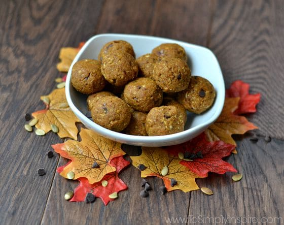 Pumpkin pie chocolate chip bites in a white bowl surrounded by Fall leaves and chocolate chips