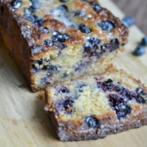 blueberry lemon bread with a slice cut