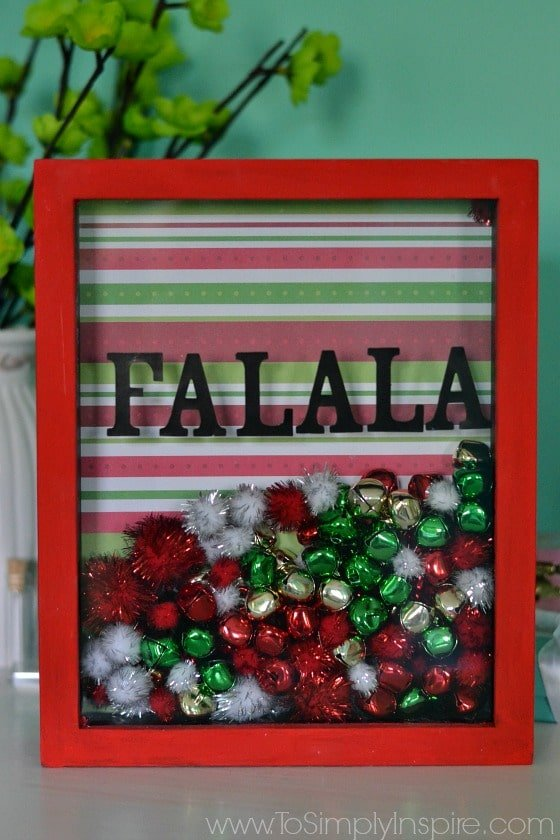 Make this easy DIY Holiday Shadowbox Frame for a cute little addition to your holiday decorations.