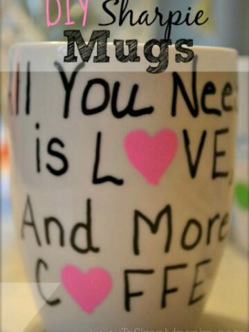 a white mug that says All you Need is Love and more coffee
