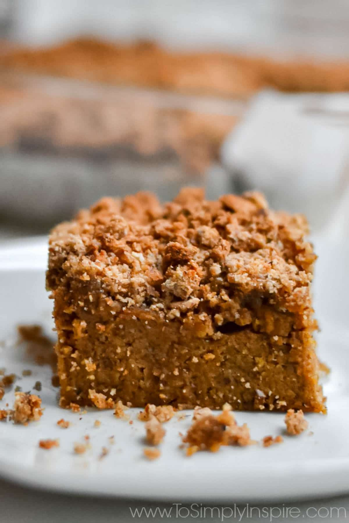 closeup of a slice of Pumpkin Coffee Cake on a white plate