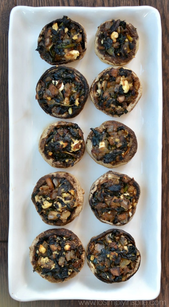 Make these healthy stuffed mushrooms for your next party or get together. They are packed with spinach and feta with a little balsamic for scrumptious flavors!