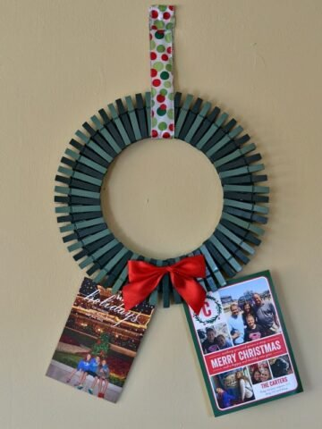 a wreath made out of painted green clothespins