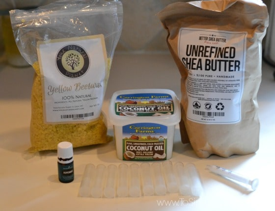 package of shea butter, bees wax, coconut oil and peppermint essential oil on a counter