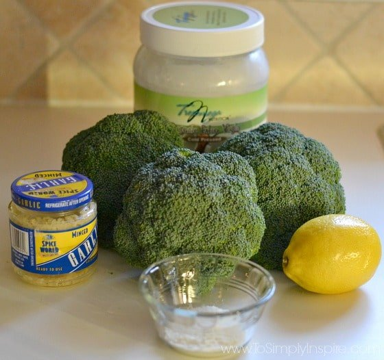 broccoli, garlic, lemon, coconut oil on a counter