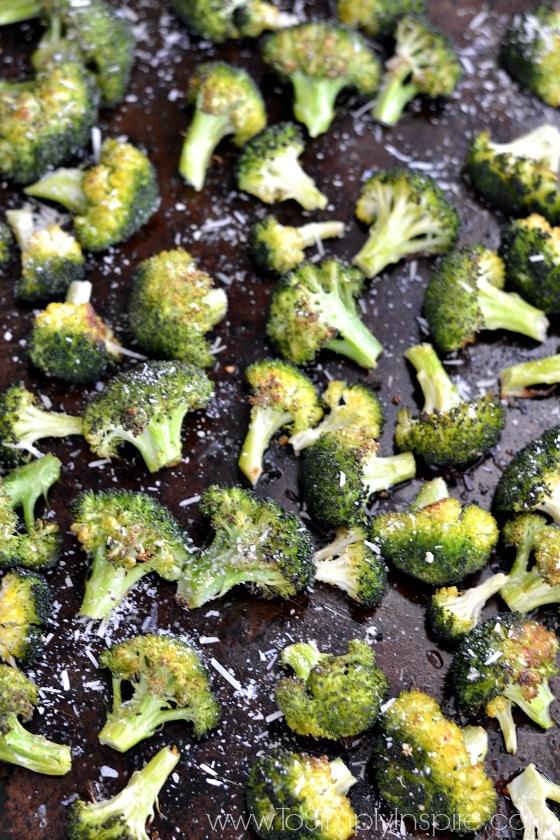 garlic parmesan roasted broccoli on a baking sheet