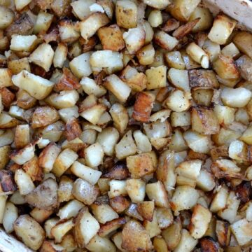 a baking dish full of diced roasted potatoes