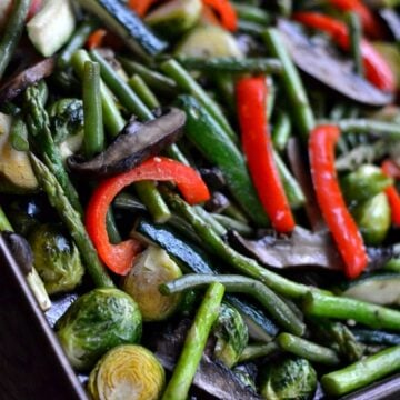 a baking sheet with a variety of roasted vegetables