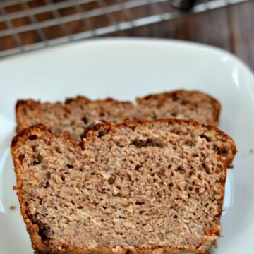 Two pieces of banana bread on white plate