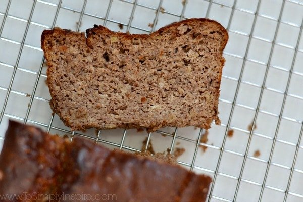 Gluten Free Banana Bread slice on a cooling rack.