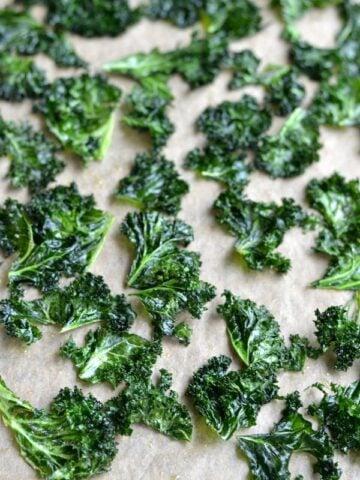 kale chips on parchment paper