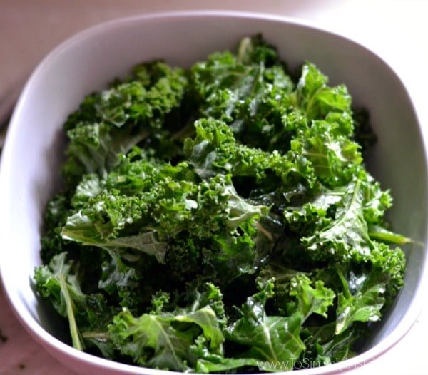 These addictive Kale Chips are the best little crunchy snack. With just a tad of oil and sea salt, you can transform this super healthy vegetable into a favorite treat.