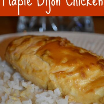A close up of a chicken breast topped with maple dijon sauce