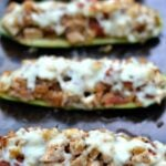 stuffed zucchini boats on a baking sheet