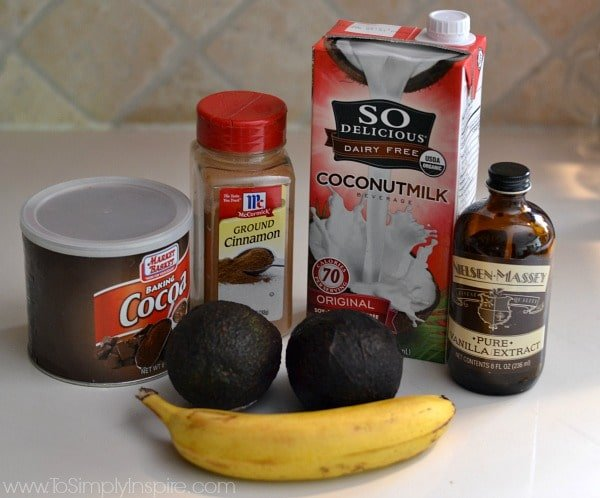 carton of coconut milk, cocoa powder, banana, avocados and cinnamon