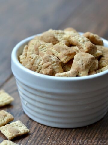 a white bowl with chex mix cereal on a wood table