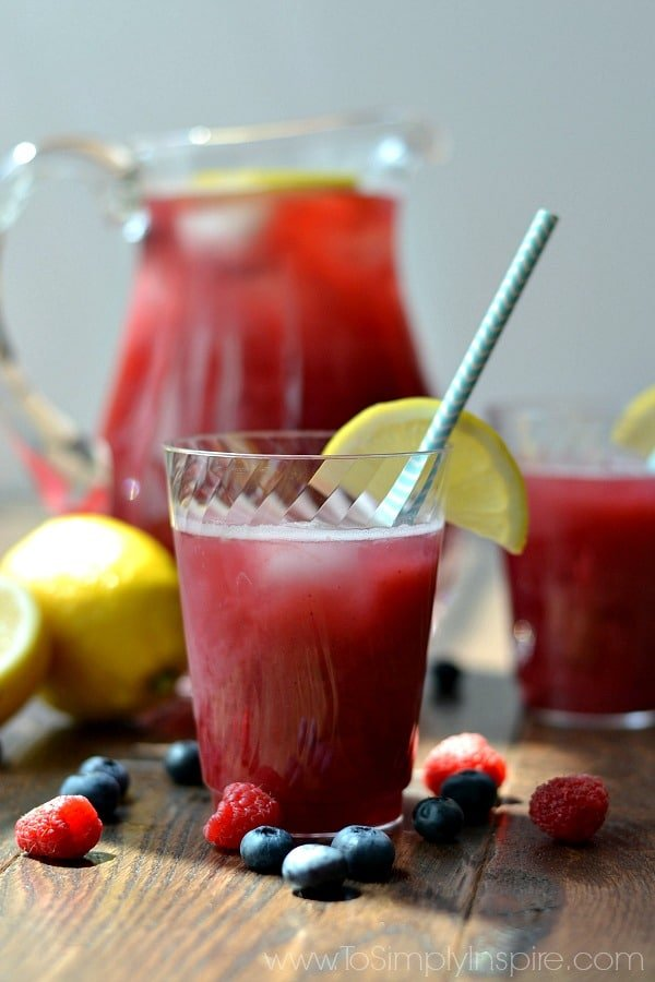 There is nothing more refreshing than Homemade Raspberry Blueberry Lemonade on a hot day! Make this simple recipe for your next get together or BBQ too.