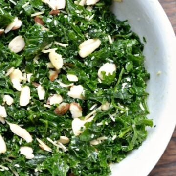 A bowl of kale salad with almond slices
