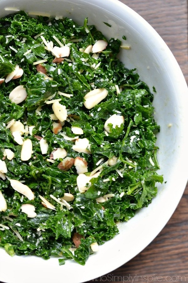 Simple Kale Salad with Lemon Vinaigrette </strong> - a healthy lunch or dinner for a busy night. Added sliced almonds and parmesan cheese pair perfectly with the tangy lemon dressing.