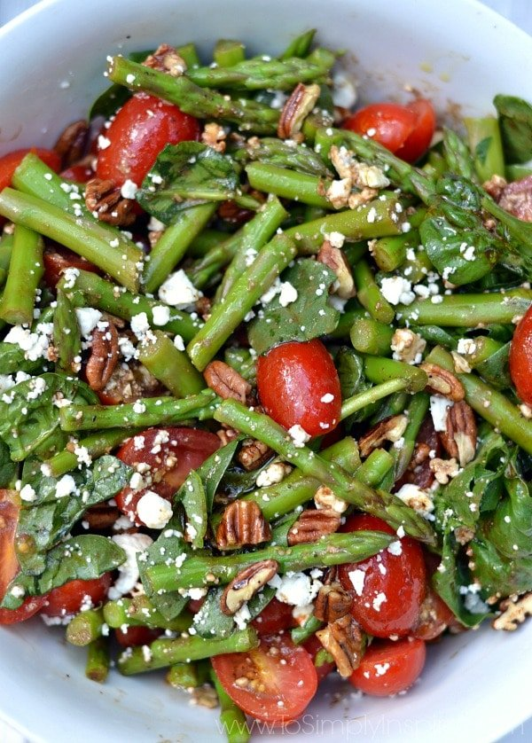 Spinach, Asparagus, Tomato Salad Recipe with tossed with toasted pecans, feta cheese and homemade Balsamic Vinaigrette. A perfect fresh salad for a meal or as a side.