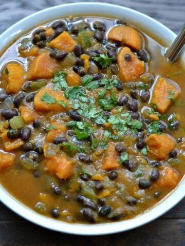 closeup of a white bowlful of sweet potato black bean soup