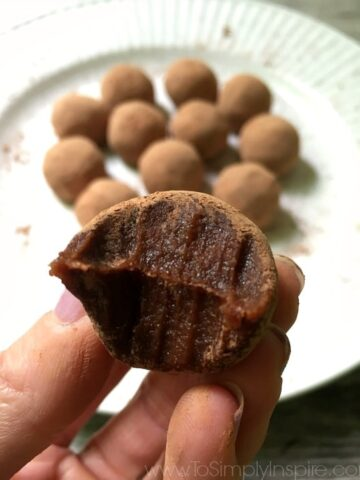 closeup of a chocolate truffle with a bite taken out