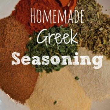 piles of seasonings on a plate with text overlay Homemade Greek Seasoning