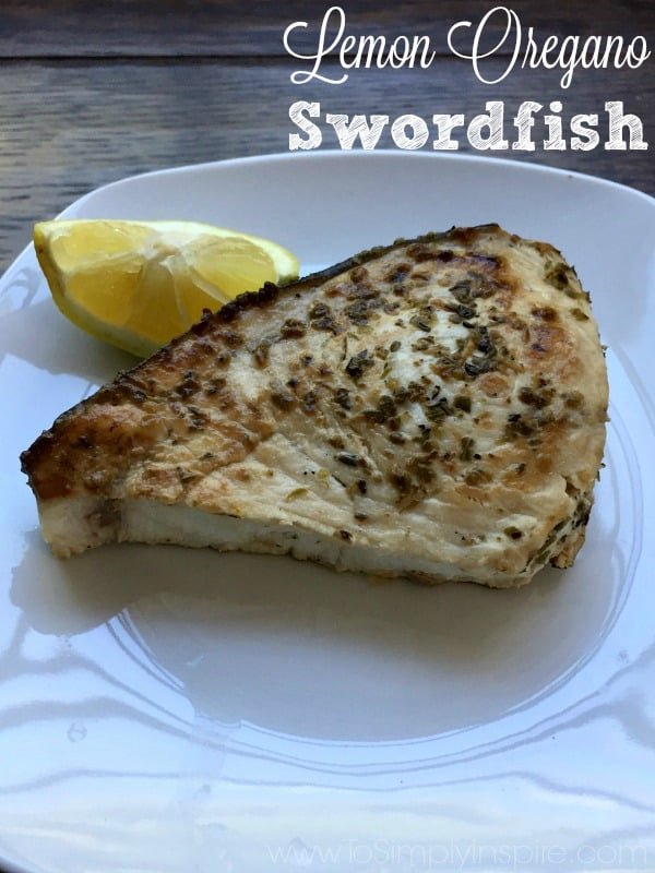 TLemon Oregano Swordfish on a white plate with lemon