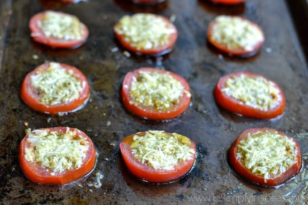 hese Parmesan Pesto Roasted Tomatoes are a wonderful, light side dish bursting with flavor. Just 3 ingredients make them so easy to make for the perfect addition to a meal.