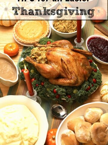 A thanksgiving turkey on a table surrounded by different side dishes