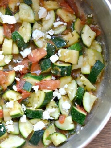 A bowl of zucchini, feta cheese and diced tomatoes