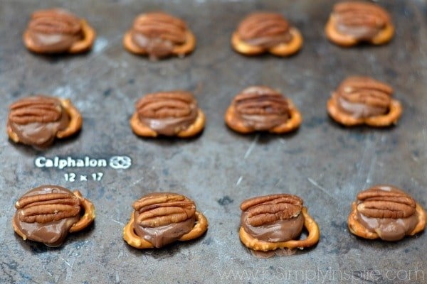 These Rolo Pretzel Turtles are the most amazing 10 minute treat you will ever make. 3 ingredients is all you need...a pretzel, a rolo and a pecan!