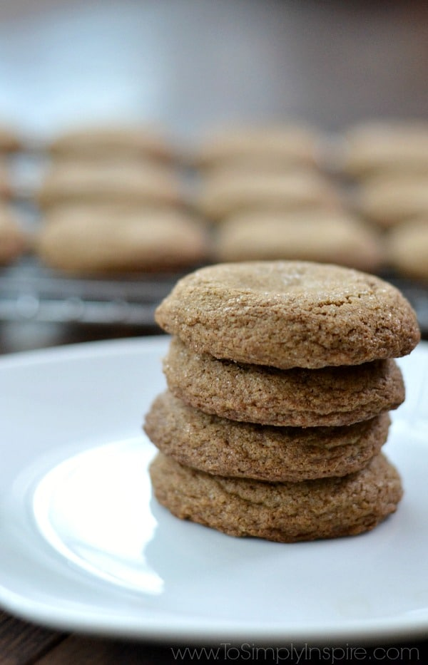 A stack of four Molasses cookies with a cooking rack in the background